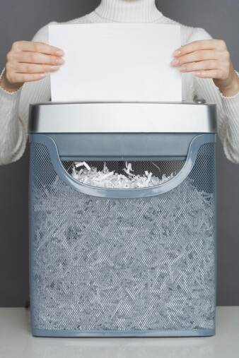 Woman using a paper shredder